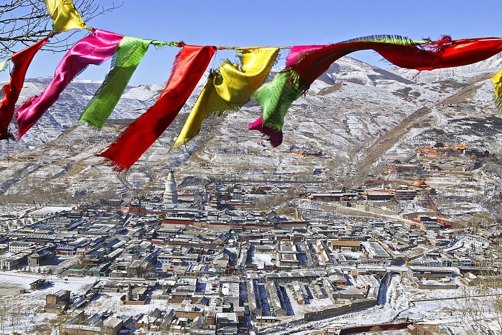 Tibetan prayer flags, view above the town of Taihuai and Wutai Shan Mountains in winter, Mount Wutai, Shanxi province, China