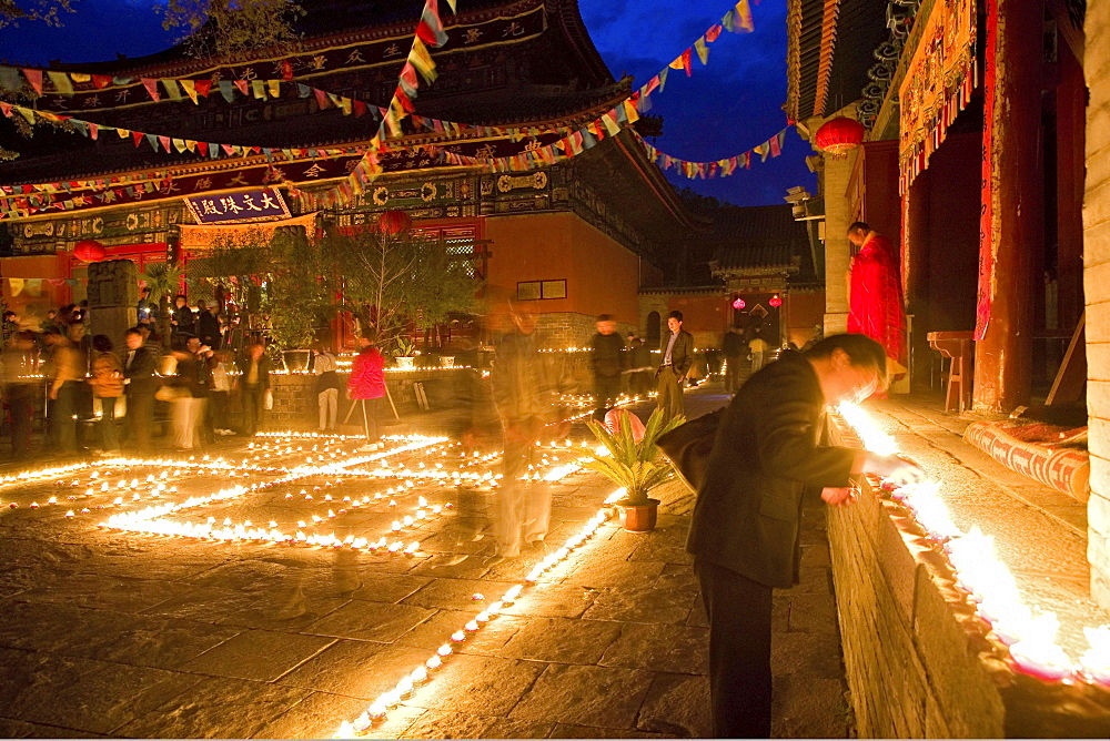 People lighting candles for the birthday celebrations for Wenshu, Shuxiang temple, Mount Wutai, Wutai Shan, Five Terrace Mountain, Buddhist Centre, town of Taihuai, Shanxi province, China
