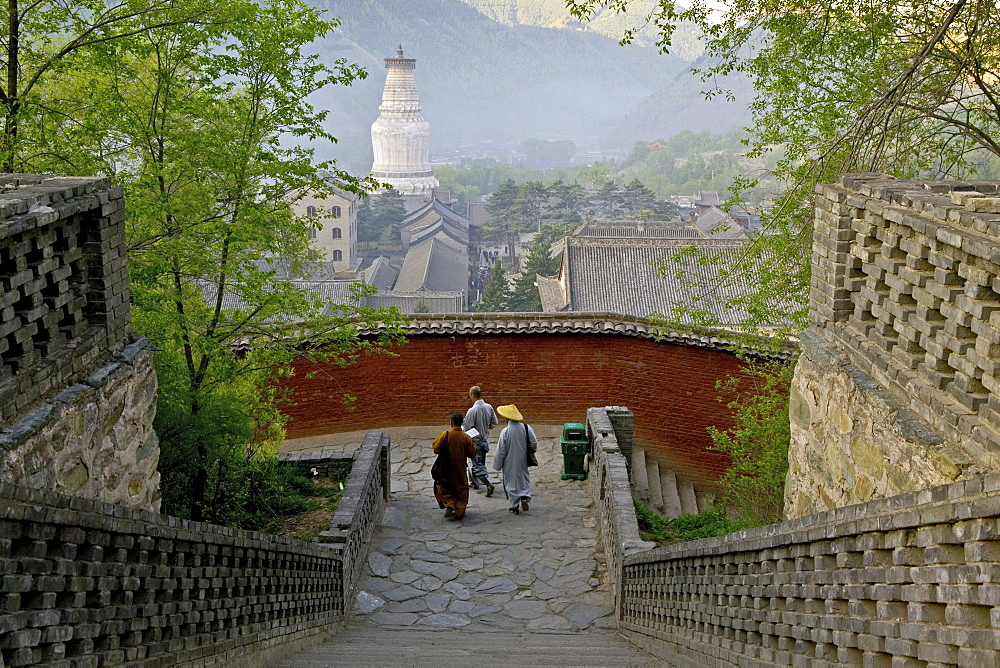 Stairs to Pusa Ding temple, White Pagoda, Xiantong Temple in the background, during birthday celebrations for Wenshu, Mount Wutai, Wutai Shan, Five Terrace Mountain, Buddhist Centre, town of Taihuai, Shanxi province, China