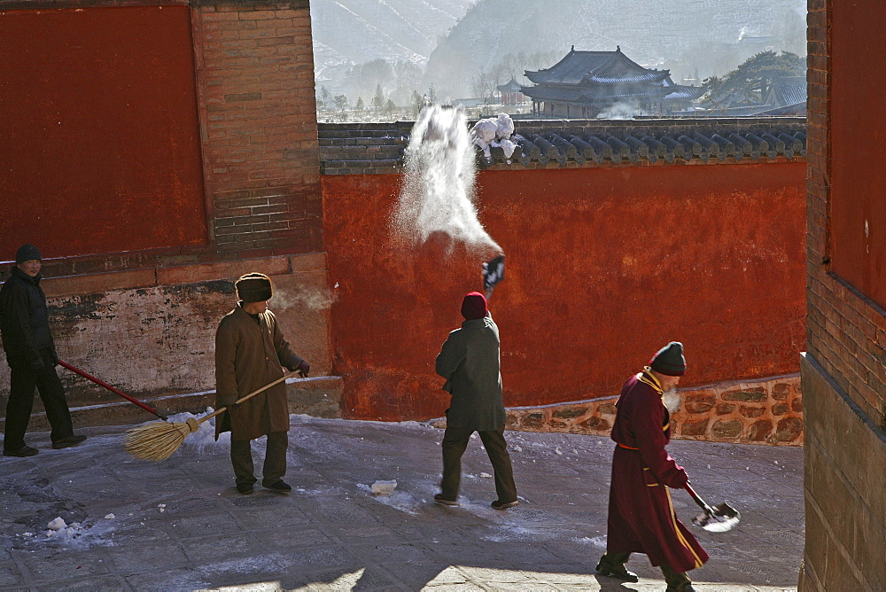 Monks clearing snow, high walls of monastery, Xiantong Monastery, Wutai Shan, Five Terrace Mountain, Buddhist Centre, town of Taihuai, Shanxi province, China