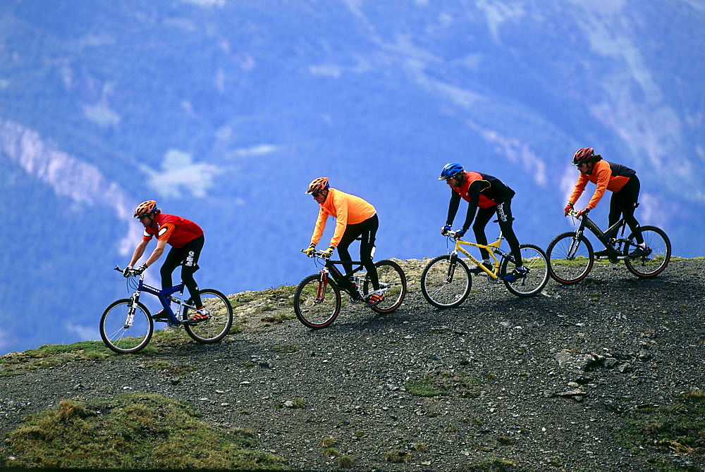 Four people on a mountainbike tour, Arosa, Grisons, Switzerland, Europe