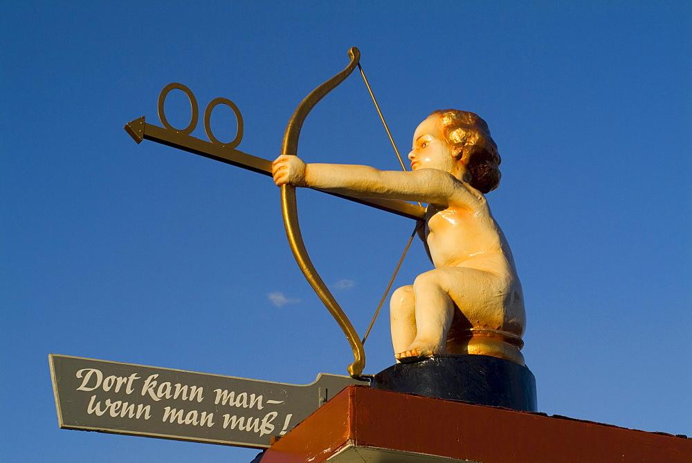Angel shows direction to Bathroom at Oktoberfest, Munich, Bavaria, Germany