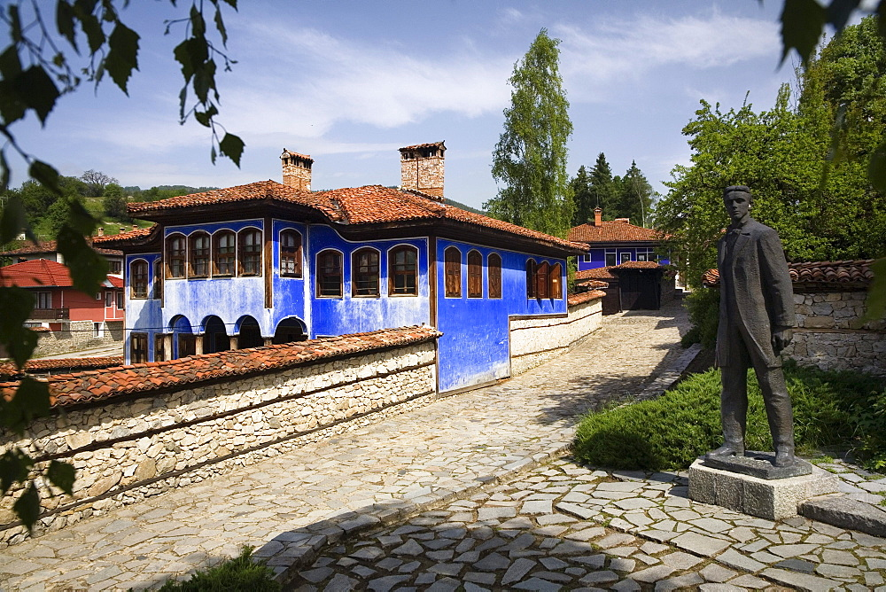 Blue house and statue, museum town Koprivstiza, Bulgaria, Europe