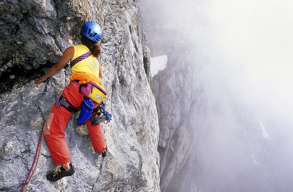 climber on south face of Dachstein, Steiner ledge, Steiner route, Dachstein range, Styria, Austria