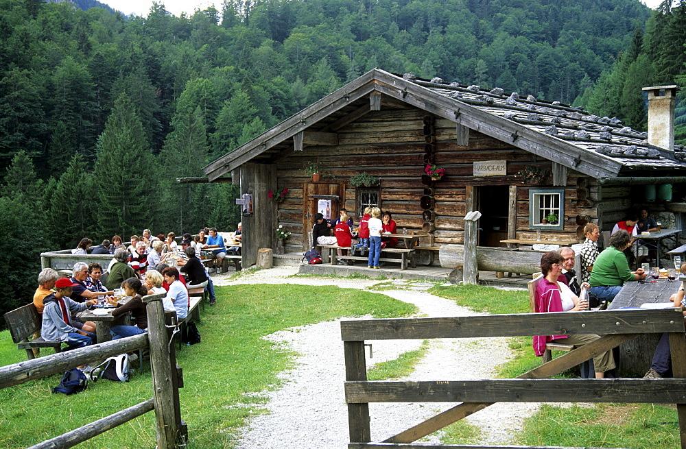 hikers having a break at alpine hut Harbachalm, Chiemgau, Upper Bavaria, Bavaria, Germany