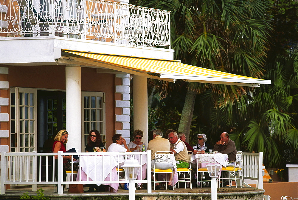 People having dinner on the terrace, Waterloo House, Hamilton, Bermuda