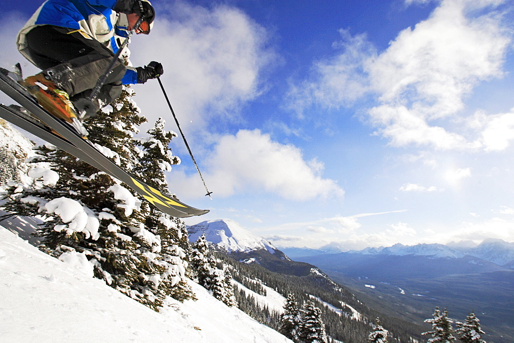 Lake Louise, Banff, a woman skis the powder snow of. Alberta, Rocky Mountains, Canada, North Amerika, MR - 1113-75093