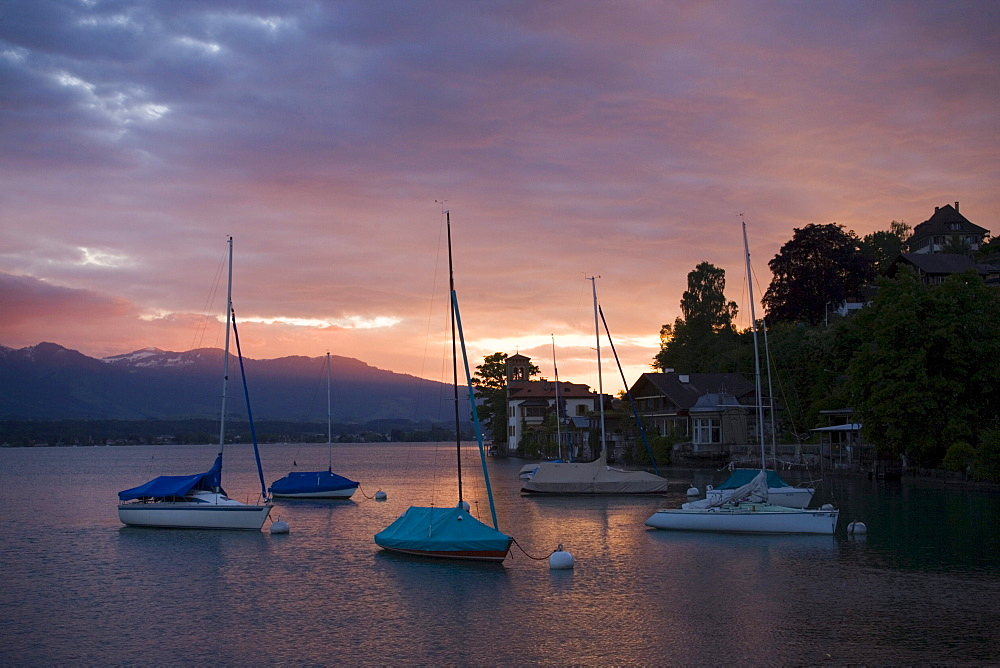 Anchoring sailing boats at surnise near Castle Oberhofen, Lake Thun, Oberhofen, Bernese Oberland (highlands), Canton of Bern, Switzerland