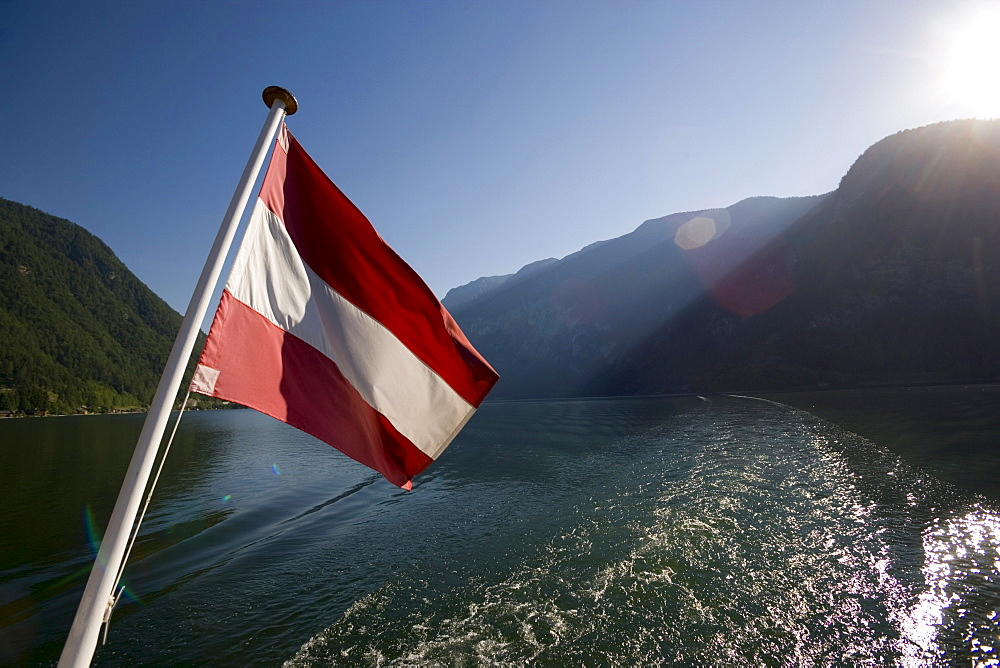 Austrian flag at stern of a ship on Lake Hallstatt, Hallstatt, Salzkammergut, Upper Austria, Austria