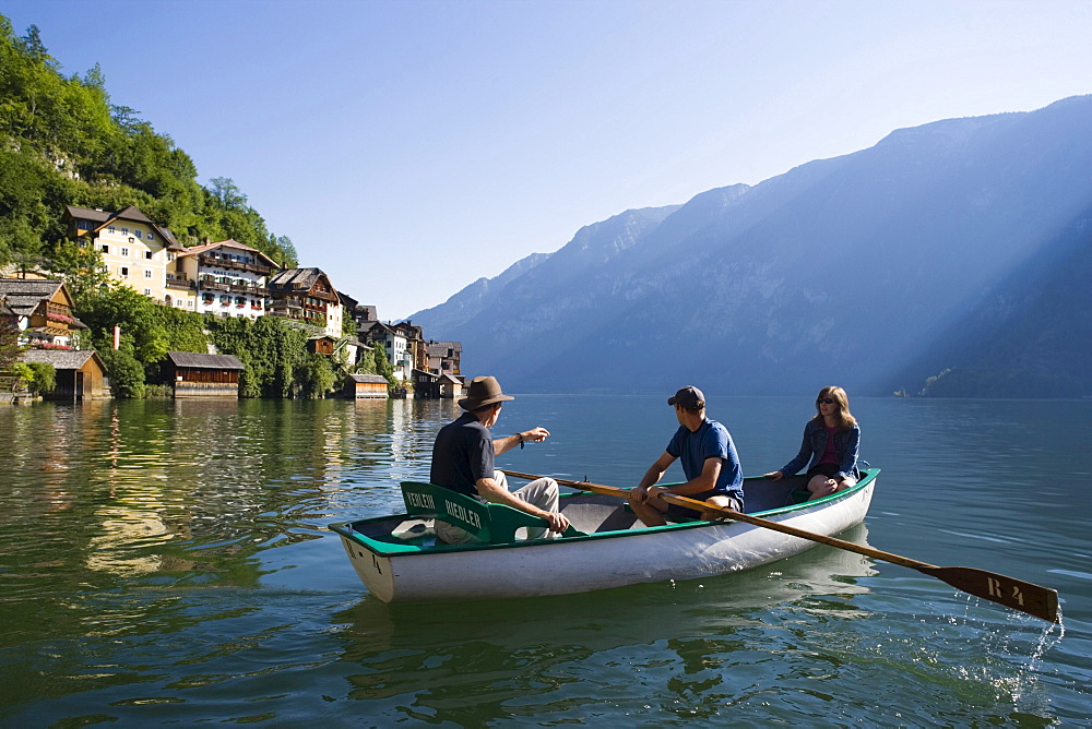 People in a rowboat on Lake Hallstatt, Hallstatt, Salzkammergut, Upper Austria, Austria