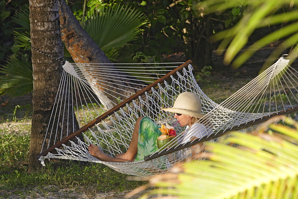 Woman with Drink in Hammock, Tonga, South Seas