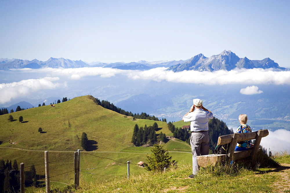 Senior couple enjoying view over Rigi Kulm (1797 m) to Pilatus (2132 m), Rigi Kulm, Canton of Schwyz, Switzerland