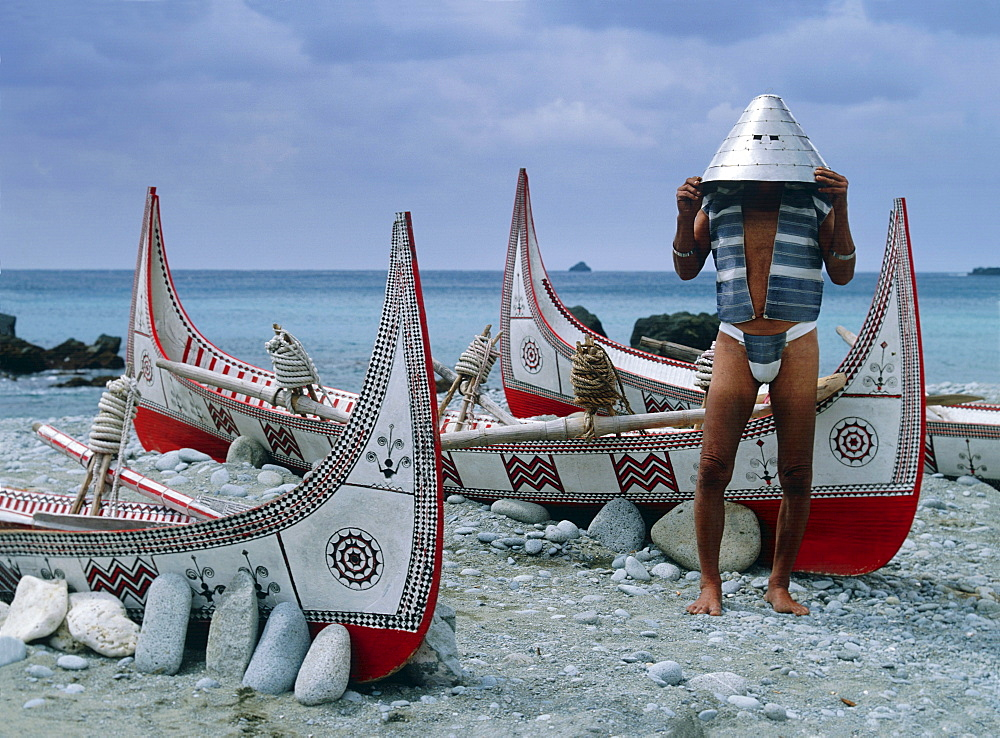 Yami tribesman with traditional helmet, Lanyu Island, Taiwan