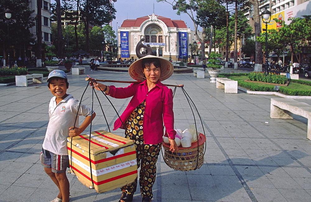 Saleswoman with child, Saigon, Ho Ch Ming City, Vietnam
