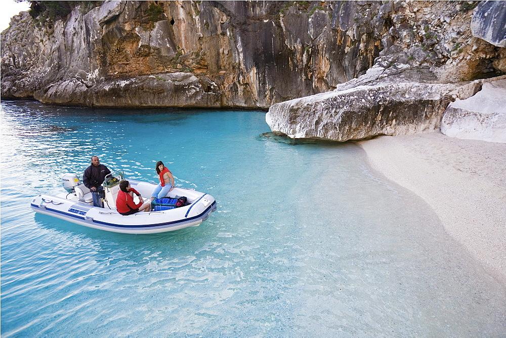 Tourists in rubber boat at Golfo di Orosei, Cala Goloritze, Sardinia, Italy
