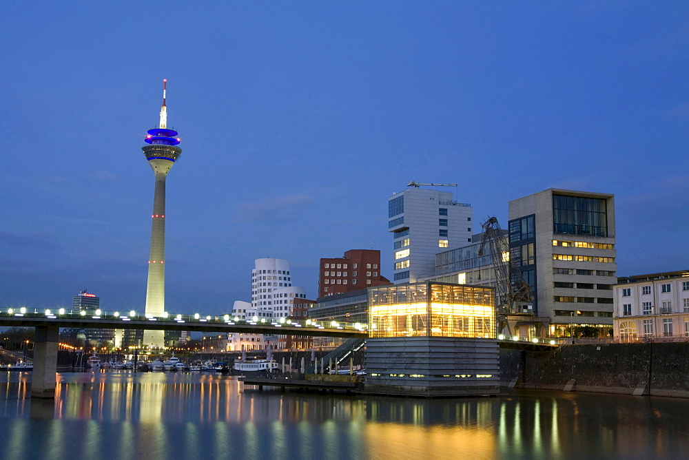 Modern architecture in the Media Harbour with television tower in the evening, Duesseldorf, state capital of NRW, North-Rhine-Westphalia, Germany