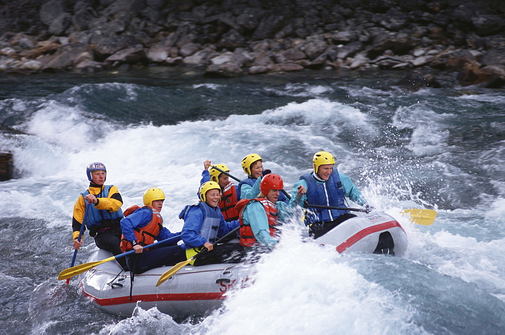 People white water rafting on the river Otta, Norway