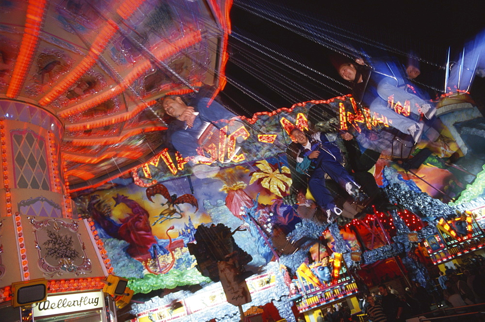 People on a swing carousel, chair-o-plane at the Octoberfest, Munich, Bavaria, Germanys