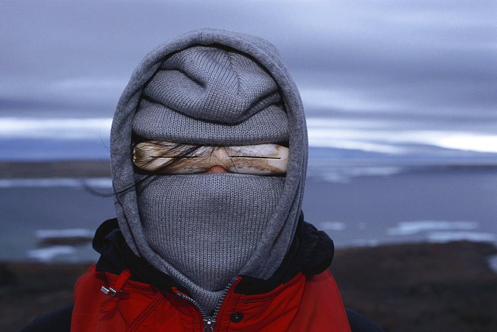 Person wearing Inuit sunglasses, Baffin Island, Nunavut, Canada