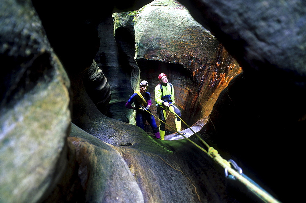 Two people canyoning in Claustral Canyon, Blue Mountains National Park, New South Wales, Australia