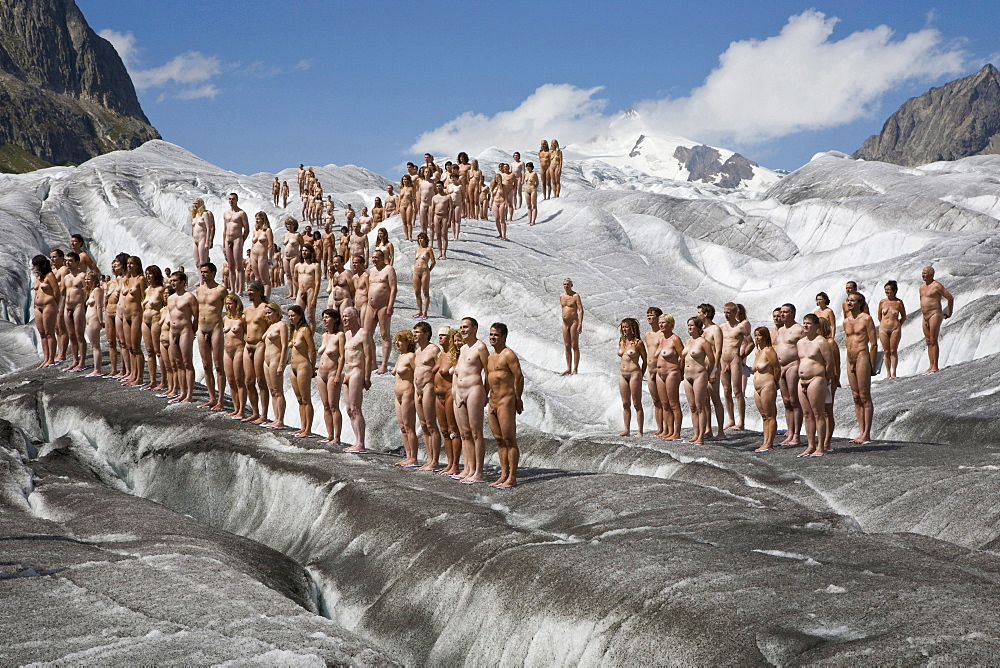 A group of naked people in front of an ice crevasse, around 600 people are posing for Spencer Tunick and Greenpeace on the Aletsch Glacier to protest about climate change, Aletsch Glacier, Valais, Switzerland
