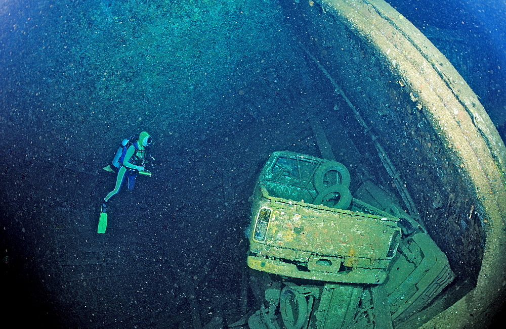 Scuba diver and Truck wreck in Blue Belt shipwreck, Sudan, Africa, Red Sea