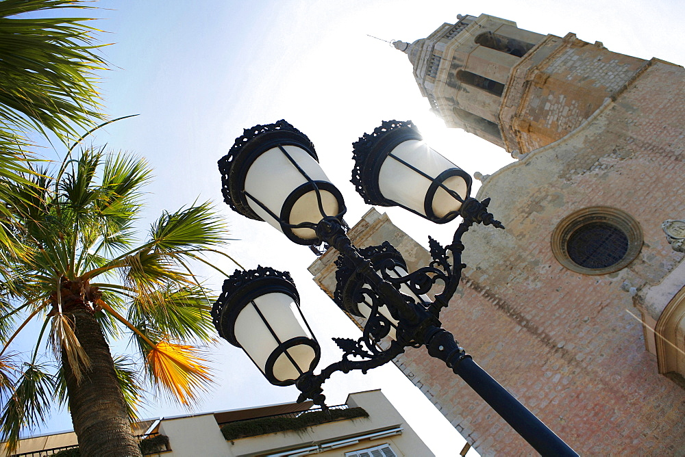 A streetlamp in front of a church, Sitges, Catalonia, Spain