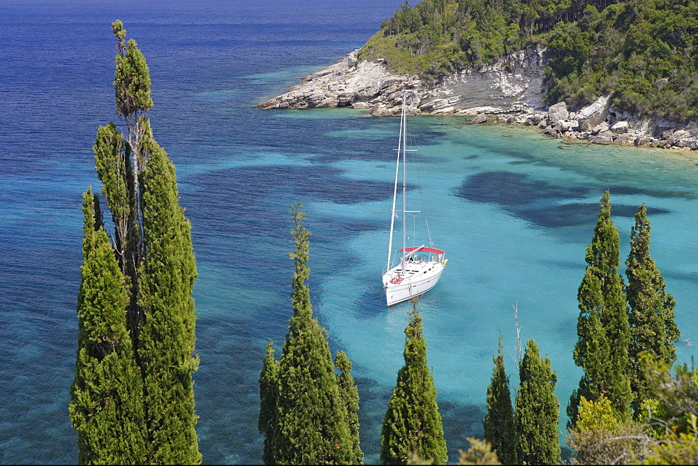 View of a boat in a bay on the Northeast coast, Paxos, Ionian Islands, Greece