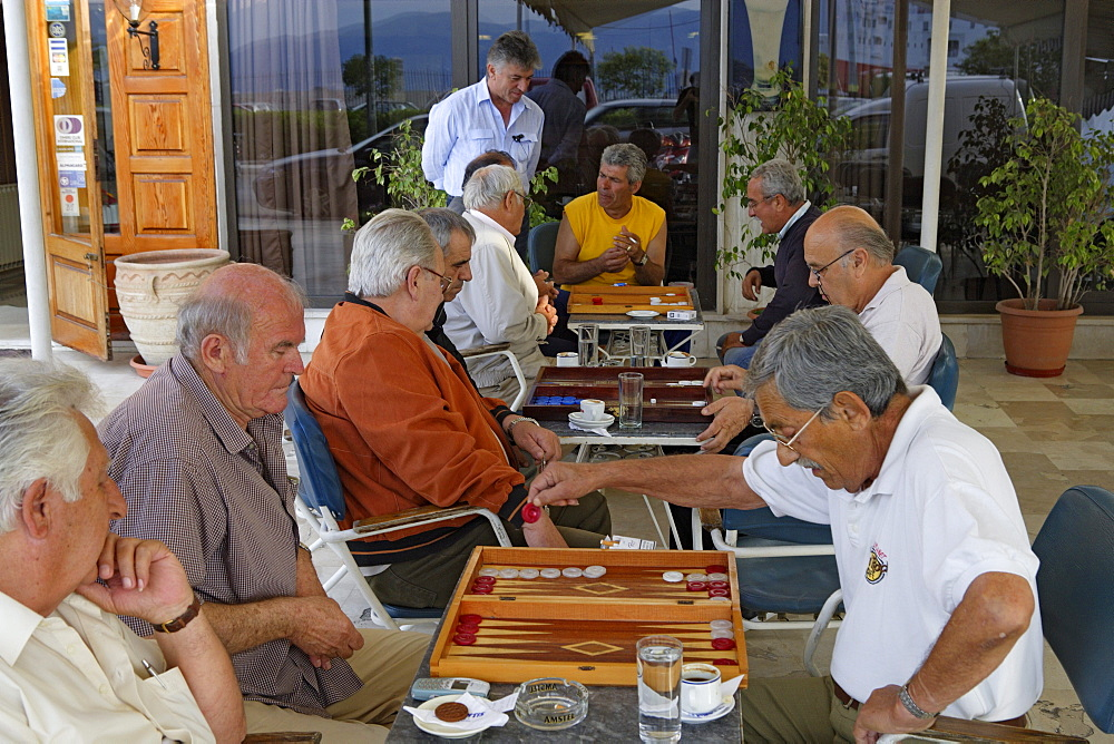 Mature men playing backgammon in a cafe, Corfu, Ionian Islands, Greece