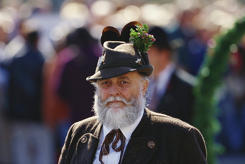 Portrait of a Bavarian man in traditional dress at a procession, Oktoberfest, Munich, Bavaria, Germany, Europe