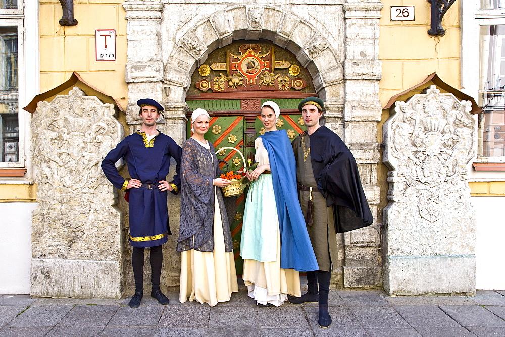 Actors in front of the entrance door of the Schwarzhaeupterhaus, Tallinn, Estonia, Europe - 1113-8559