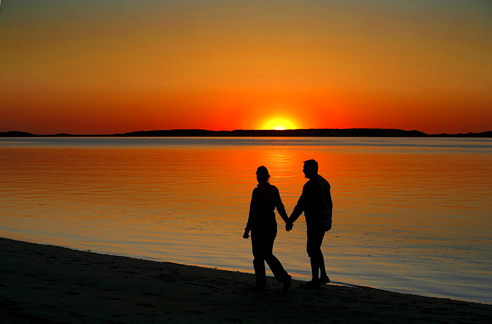 A couple enjoying the sunset, Wellfleet Harbor, Cape Cod, Massachusetts, USA