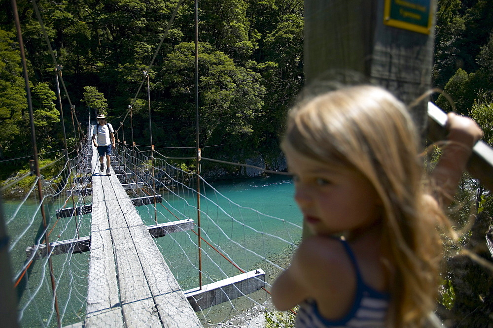 Girl on hanging bridge, track to Blue Pools, east of Haast Pass, Southern Alps, South Island, New Zealand