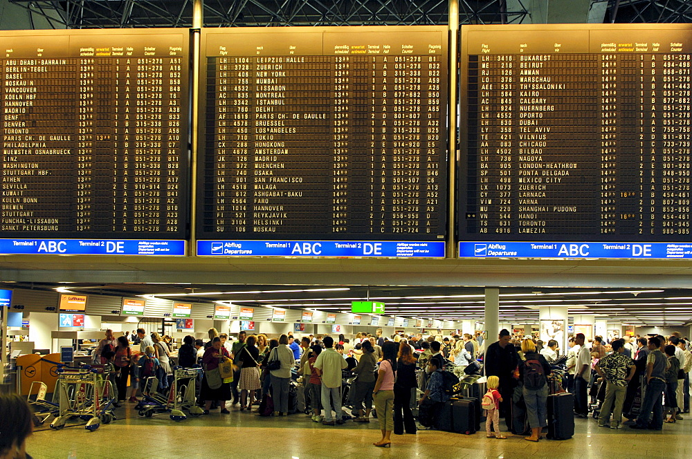 People, Travellers waiting at the flight information board, Frankfurt Airport, Hesse, Germany