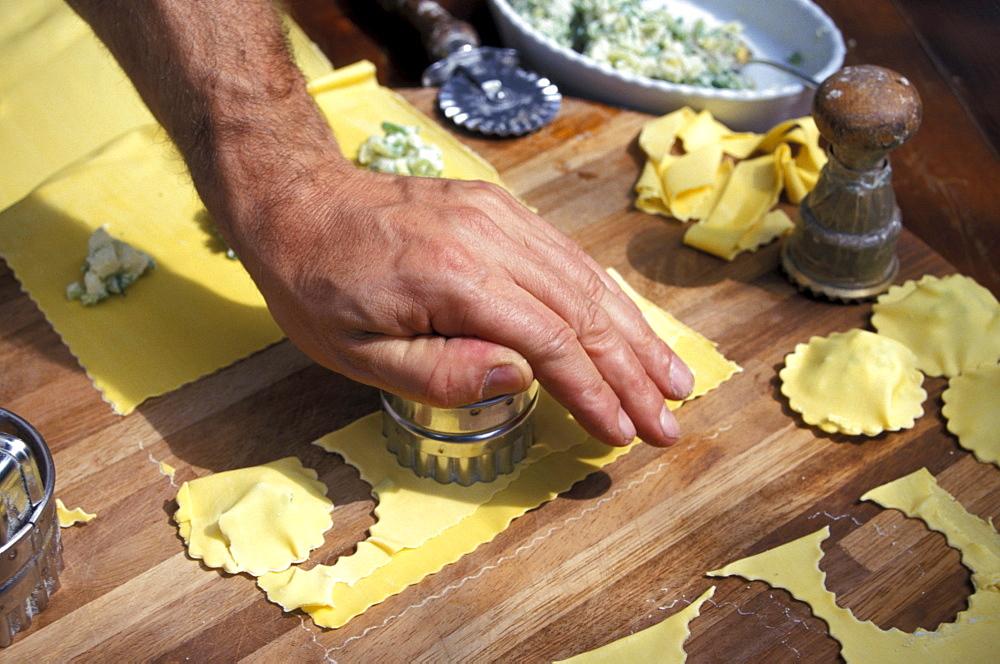 Man preparing pasta, restaurant La Campagnola, Salo, Lake Garda, Lombardy, Italy