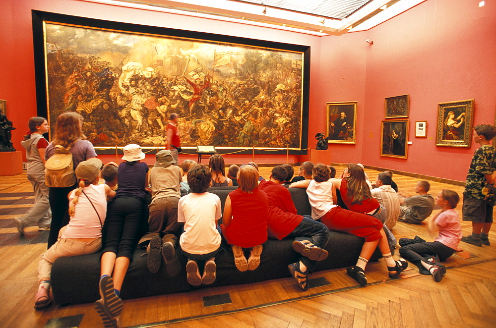 Children looking at painting, National Museum, Warsaw, Masovian, Poland
