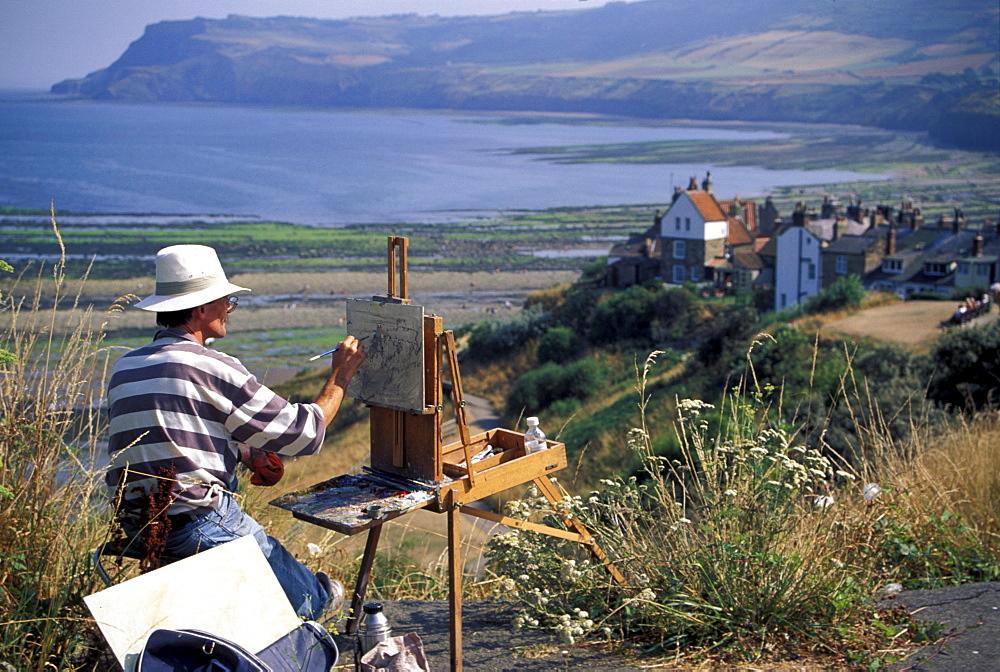 Man painting Robin Hood's Bay, North Yorkshire, England, United Kingdom