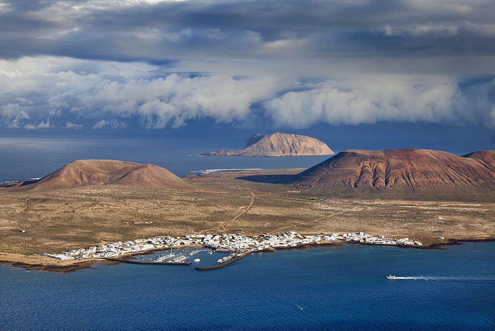 View of the island of La Graciosa under clouded sky, Lanzarote, Canary Islands, Spain, Europe