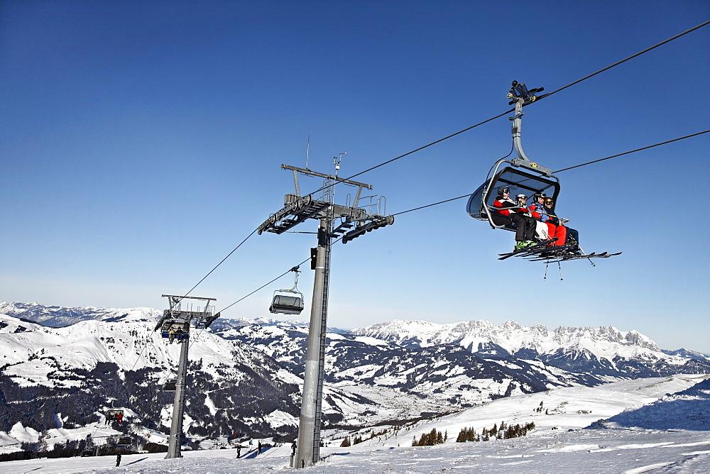 Skier in the chair lift, Ski Resort Pengelstein, Lift, Kirchberg, Kitzbuhel, Tyrol, Austria