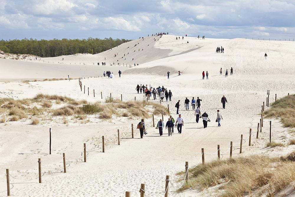 Tourists walking in the dunes, UNESCO World Biosphere Reserve, Slowinski National Park, Polish Baltic Sea coast, Leba, Pomeranian, Poland