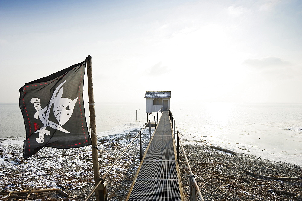 Stilted house with pirate flag, Wasserburg, Lake Constance, Bavaria, Germany