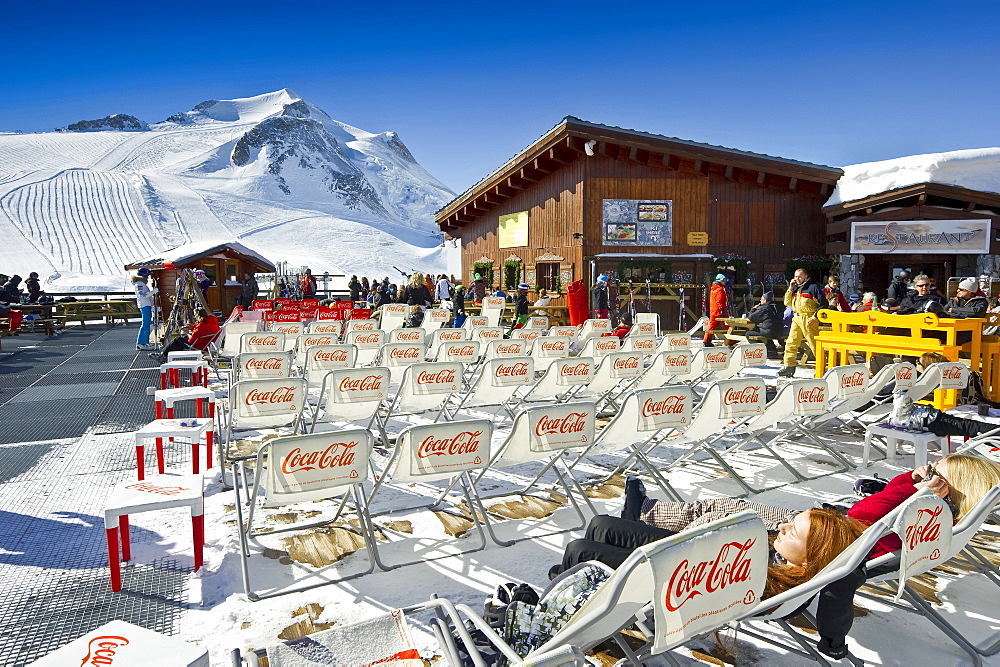 Deck chairs outside a mountain restaurant, Tignes, Val d Isere, Savoie department, Rhone-Alpes, France