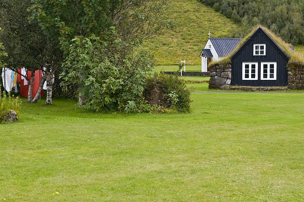 Church and traditional house in Skogar museum, Skogar, Iceland, Scandinavia, Europe