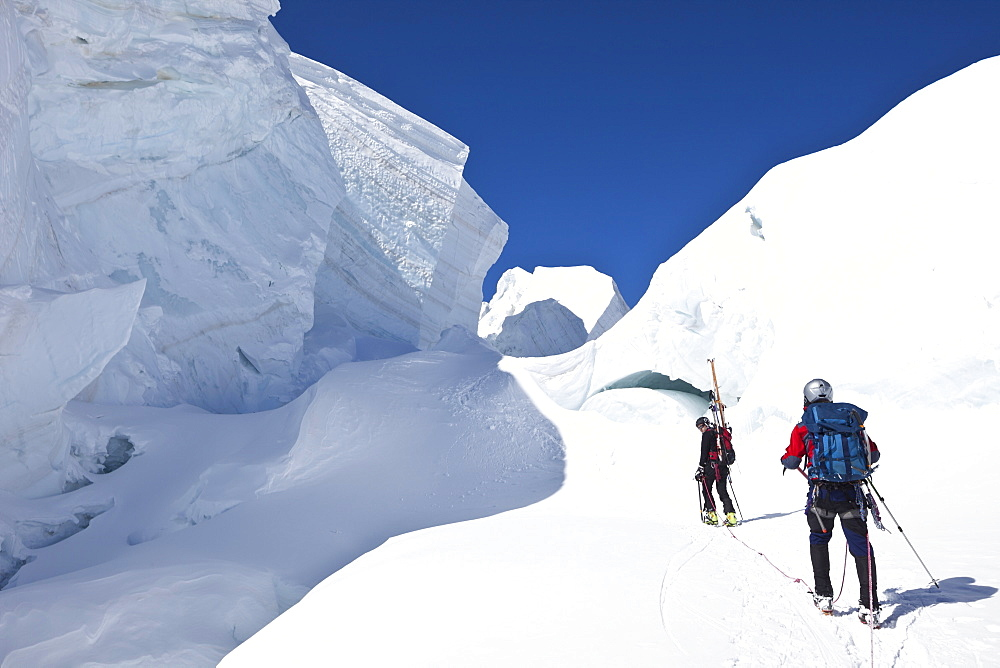 Ski mountaineers in a crevasse, Mont Blanc du Tacul, Chamonix, Mont-Blanc, France