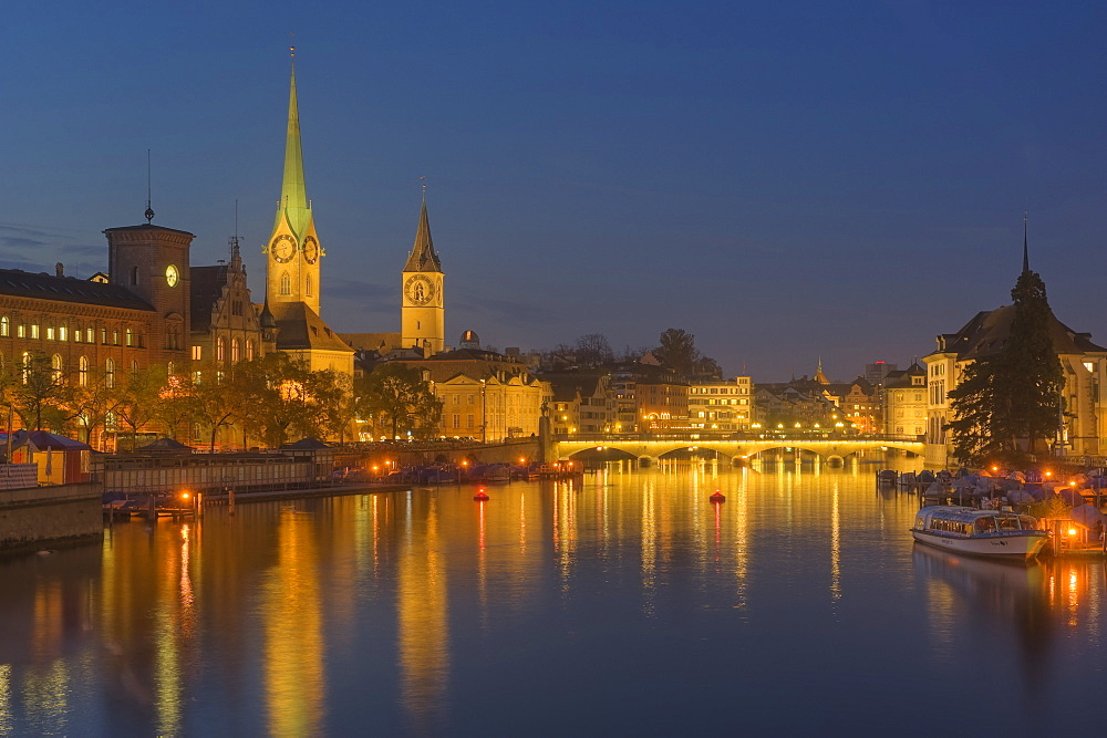 Limmat with Fauenmunster and St Peter church, dusk, Zurich, Switzerland