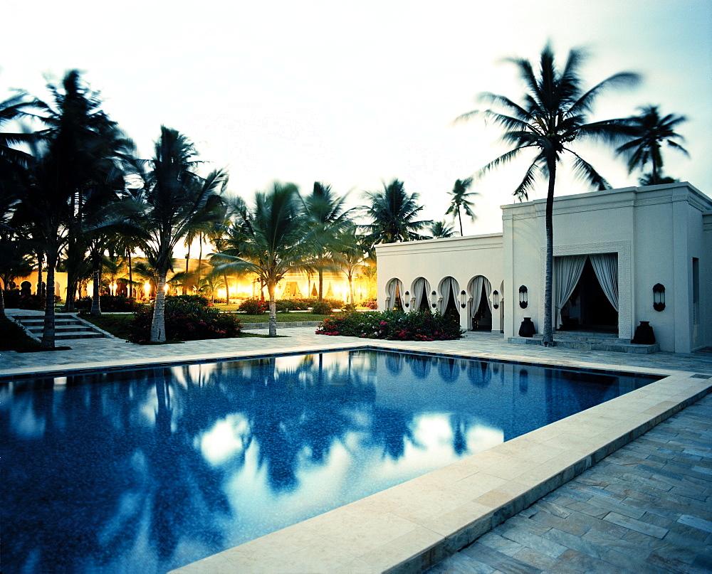 Courtyard with palm trees, Restaurant and Pool of Baraza Spa and Resort in Bwejuu, East Coast, Zanzibar, Tanzania, East Africa