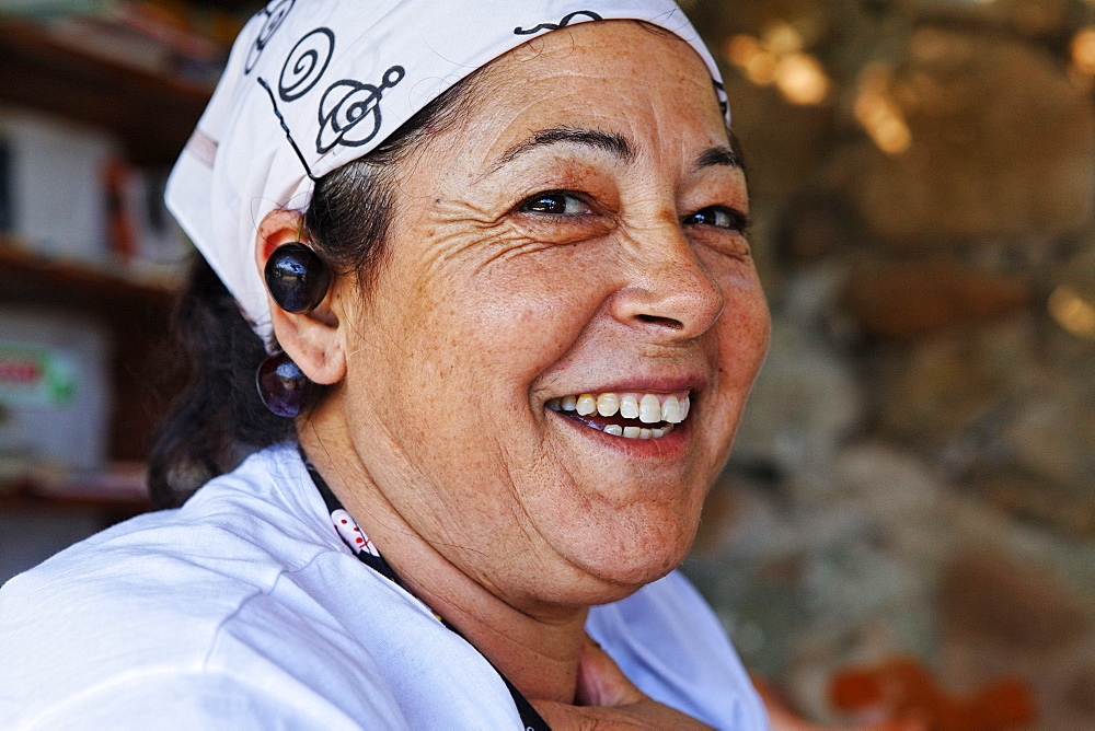 Woman in the kitchen of a restaurant, Island of Ponza, Pontine Islands, Lazio, Italy, Europe