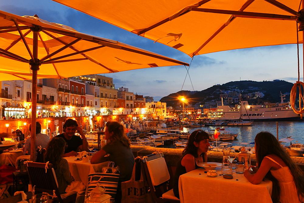 People at the terrace of the restaurant Aqua Pazza, Island of Ponza, Pontine Islands, Lazio, Italy, Europe