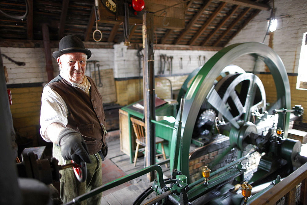 Volunteer explains steampowered flywheel to visitors, The Iron Gorge Museums, Blists Hill Victorian Town, Ironbridge Gorge, Telford, Shropshire, England, Great Britain, Europe