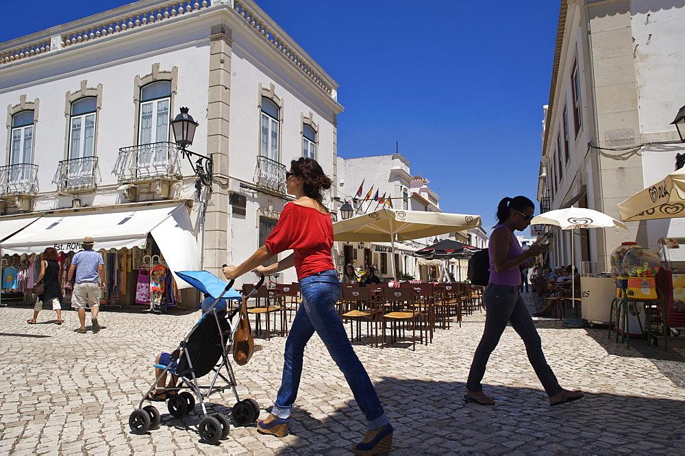 People walking in the sunny city center of Vila Real de Santo Antonio, Algarve, Portugal, Europe